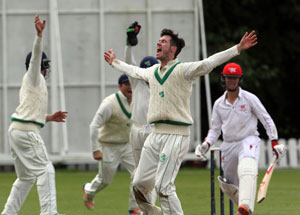 George Dockrell celebrates the wicket of Carter as Ireland beat Hong Kong by 70 runs