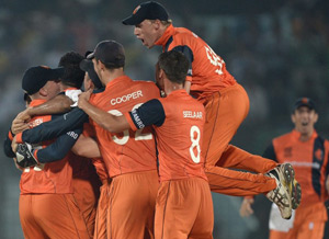 Dutch players celebrate the fall of the final wicket to complete their 45 runs victory over England.