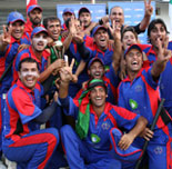 Winners Afghanistan celebrate with the trophy after beating Hong Kong in the final